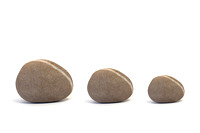 Three Pebbles against White Background